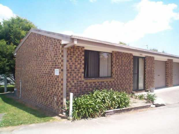 Tidy one bedroom brick unit, easy walking distance to main street, electric kitchen, garage attached.