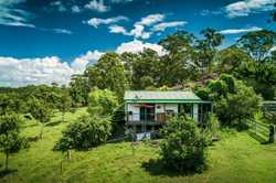 Modest 2 bedroom relocatable cottage, situated next to the main house, open plan kitchen, dining & l...
