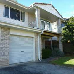 Spacious and modern two story town house with 3 bedrooms, all with built-ins, plus two bathrooms.