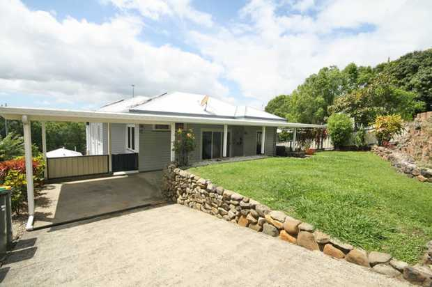 Classically designed and solidly constructed of her 1950's era, this elevated, eastern facing...