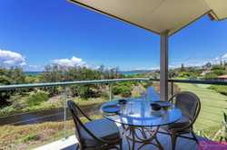 This two story one bedroom apartment features stunning ocean views of Sapphire Beach and is a great...