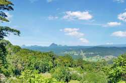 With amazing views of the famous Glasshouse Mountains, this lush 147-acre property offers a lifestyl...