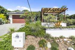 Beautiful gardens in this tropical bush setting compliment a superbly finished home offering seclusi...