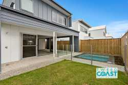 Live in style in this sleek almost brand new two storey beach side property.   Downstairs featuring...