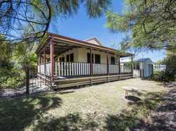 - Two Bedrooms - Large Verandah - Private, fully fenced yard - Multipurpose 12 x 5m steel frame gara...