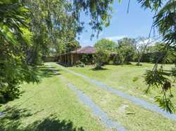 This tastefully renovated single level double brick home, encompassed by wrap around verandas, is si...