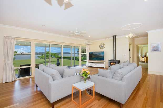 This luxurious riverfront home boasting panoramic water and landscape views is something we rarely find...