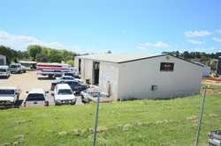 Located in the Tenterfield Industrial area is this 450m² (approx) commercial shed, currently occupie...