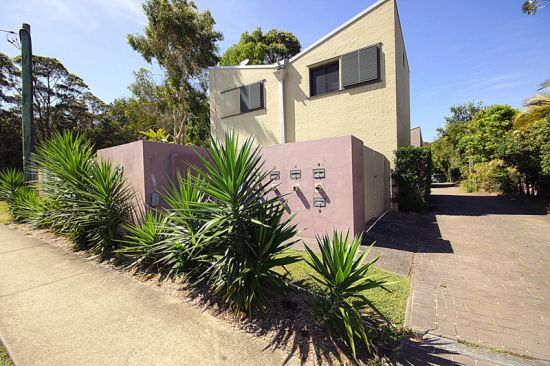 This freestanding contemporary designed townhouse is located in a small complex of four. Close to be...