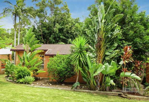 Hidden behind this delightful garden is a three bedroom, brick and tile home with a nice outlook ove...