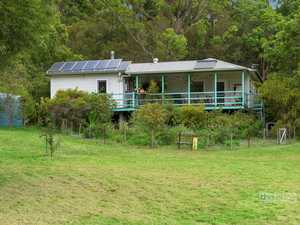 Charming home with guest accommodation on 5 (approx.) parklike acres...