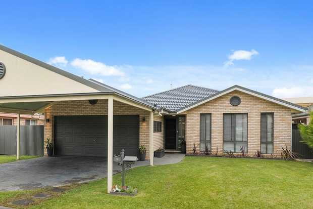 Designed for effortless family living, this stylish Coffs Harbour home features a sleek open plan de...