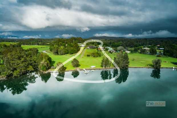 Capturing exquisite views over the picturesque Urunga River and The Great Dividing Range, this...