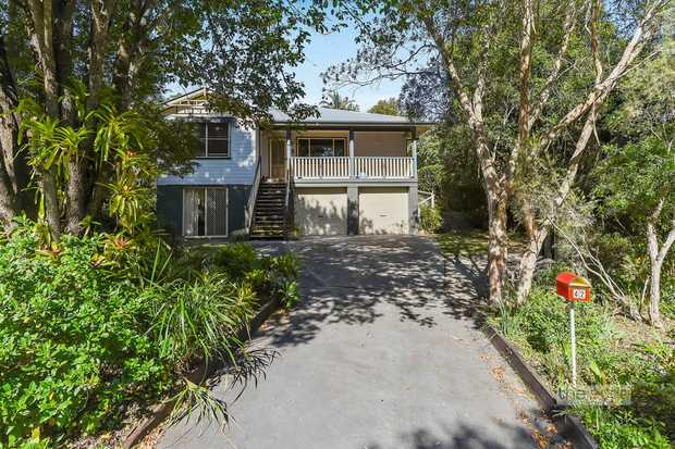 You will fall in love with all this Queenslander style home has to offer.  A romantic rear garden th...