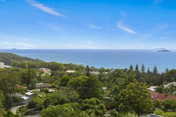 This master built 4 or 5 bedroom home is located in Korora Bay, one of Australia's most desired east...