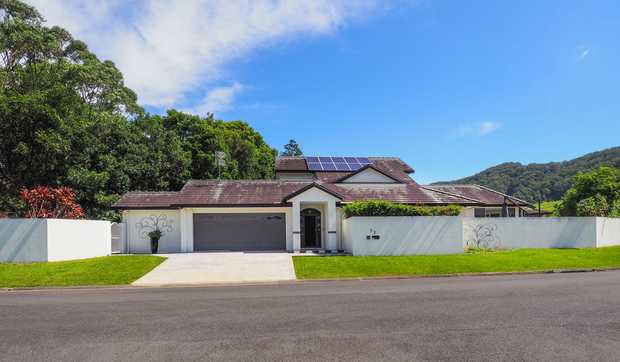 Street impressive architectural designed high ceiling large home in Coffs Harbour that gives you...