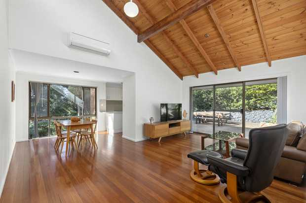 Lovely naturally lit duplex with high raked wooden ceilings. Open plan living/dining area with a modern...
