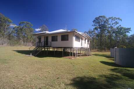 This great family  home is on 2 ha approx. 5 acres Partly fenced  This low set Queenslander has been...