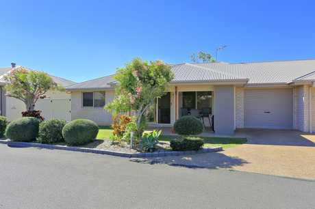 Positioned in an outstanding must see and home proud security gated boutique complex is this easy care...