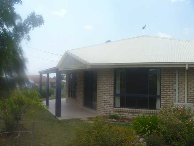 Modern home with open plan living/dining/kitchen area with air-con. The kitchen has a island bench with...