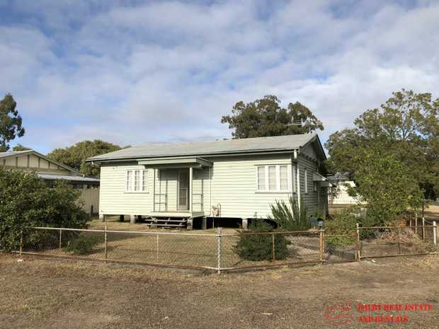 UNDER APPLICATION - 3 bedroom home has tidy kitchen with gas cooktop; ceiling fans throughout in fully...