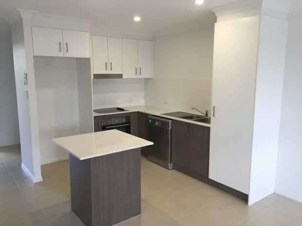 Well Appointed 2 bedroom Townhouse with the following features:  - Ultra Modern Kitchen with Electric...