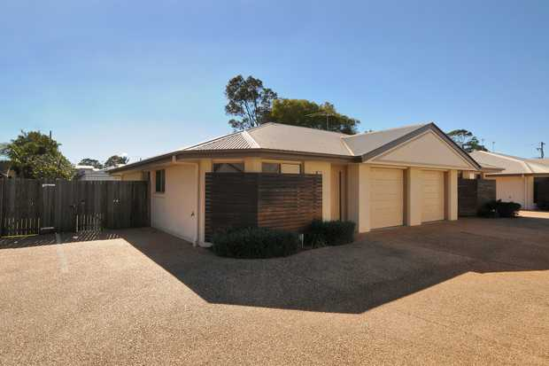 This wonderful unit situated at the back of the complex features the following;  - Carpeted Living Area...