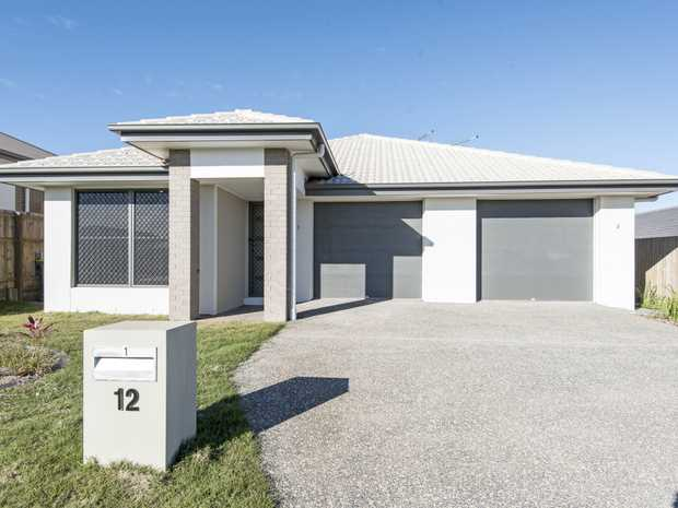Inspect this neat and tidy unit  - with open plan tiled living area and air conditioning for your...