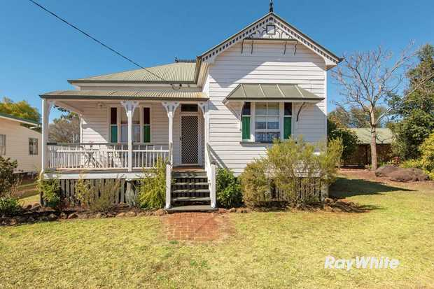 Set on a huge block with the convenience of inner city living, this gable style with a quaint front...