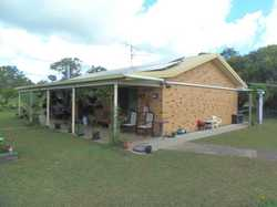 Situated 3 minutes from Kilkivan is a very neat 3 bedroom lowset steel framed brick home on a pleasa...