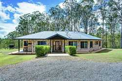 Would you like to live half way between Gympie and Tin Can Bay on acreage in an immaculately present...