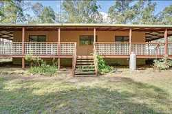 15 minutes north of Gympie is a 3 bedroom lowset split block home set on a picturesque, fully fenced...
