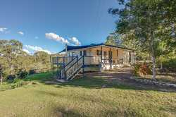 Would you like to live close to town on approximately five, flood free acres with a bitumen road run...