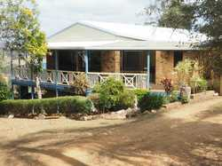 Approx. 10 minutes north west of Gympie is this large 4 bedroom highset brick home on a very private...