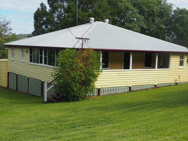 Situated in the heart of Goomeri is a multi level 4 bedroom timber Queenslander on a large half acre...